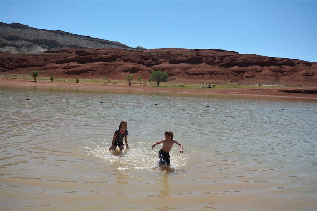 Kids playing at Horseshoe Bend Swim Beach in Bighorn Canyon National Recreation Area