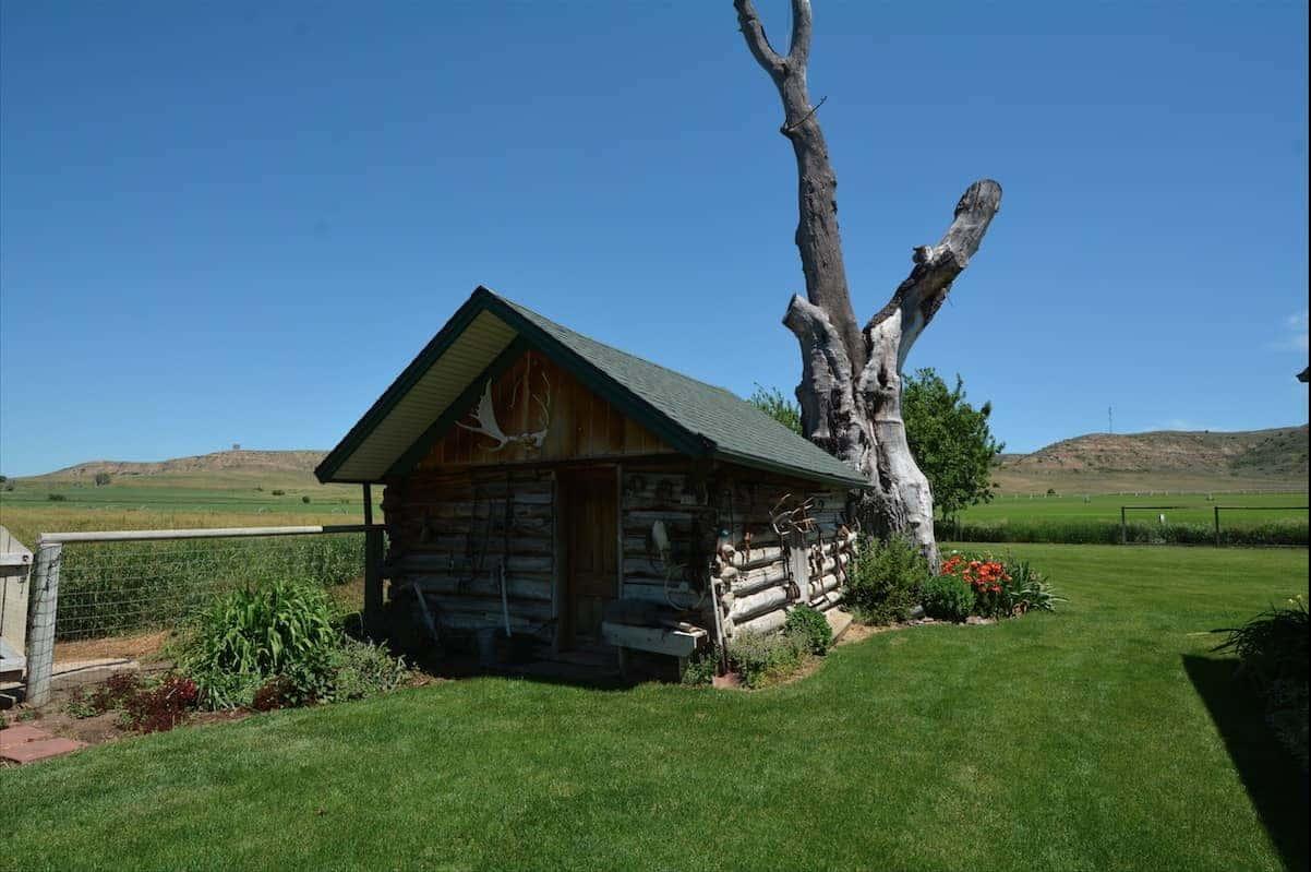 Historic Cabin and Farmland Beyond Outside of Sheridan Wyoming