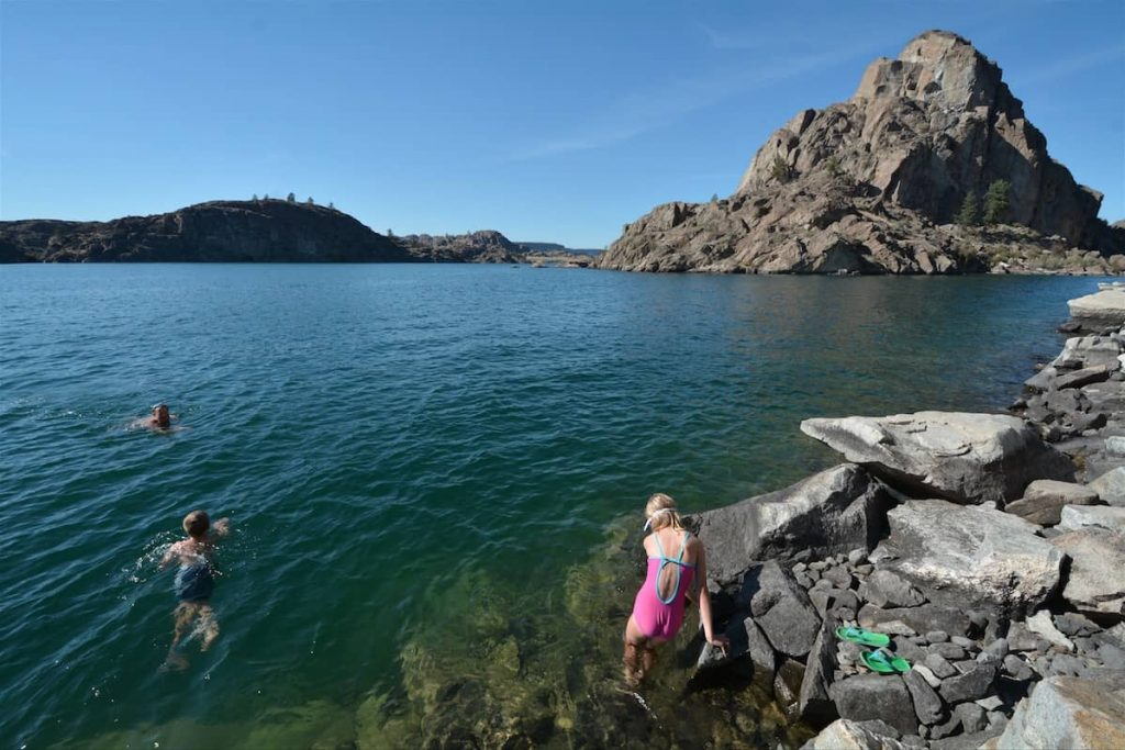 A family swimming near Grand Coulee Dam in eastern Washington