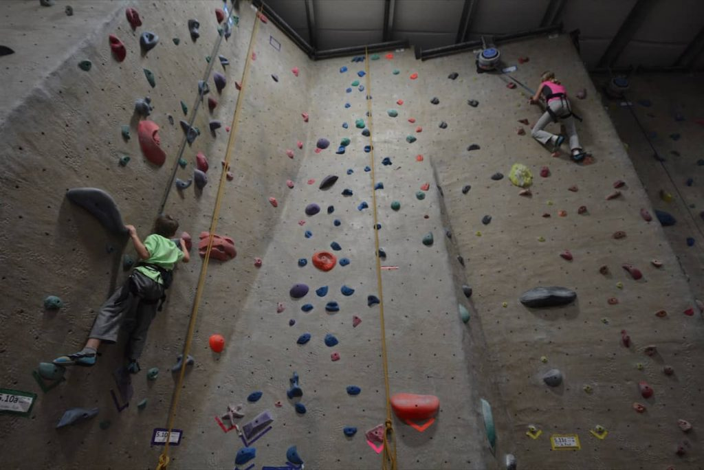 Children climbing an indoor rock climbing wall in Medford Oregon