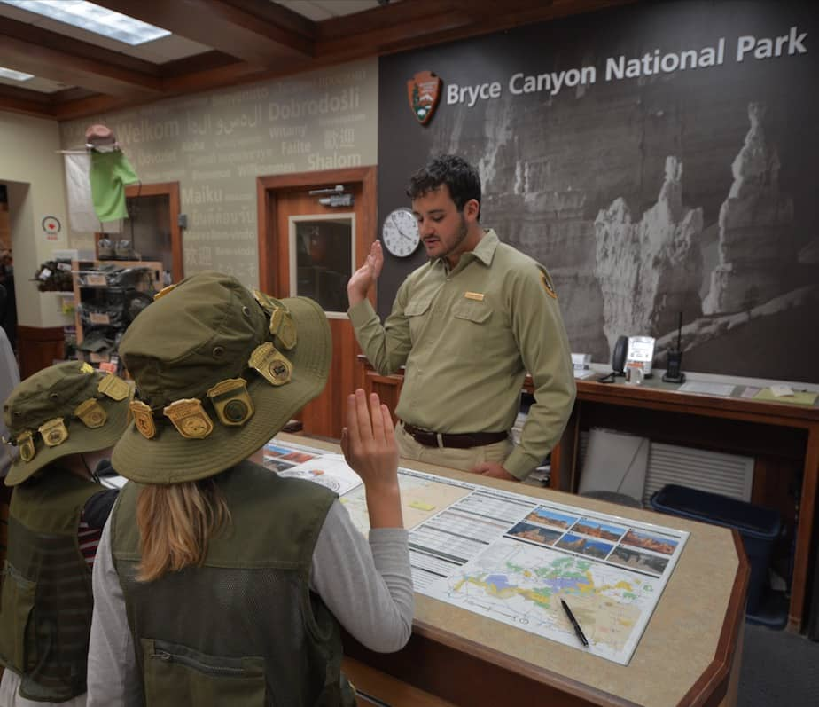 Two kids being sworn in as Junior Rangers in Bryce Canyon National Park