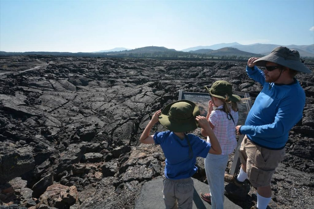 A family overlooks Craters of the Moon National Monument in southern Idaho
