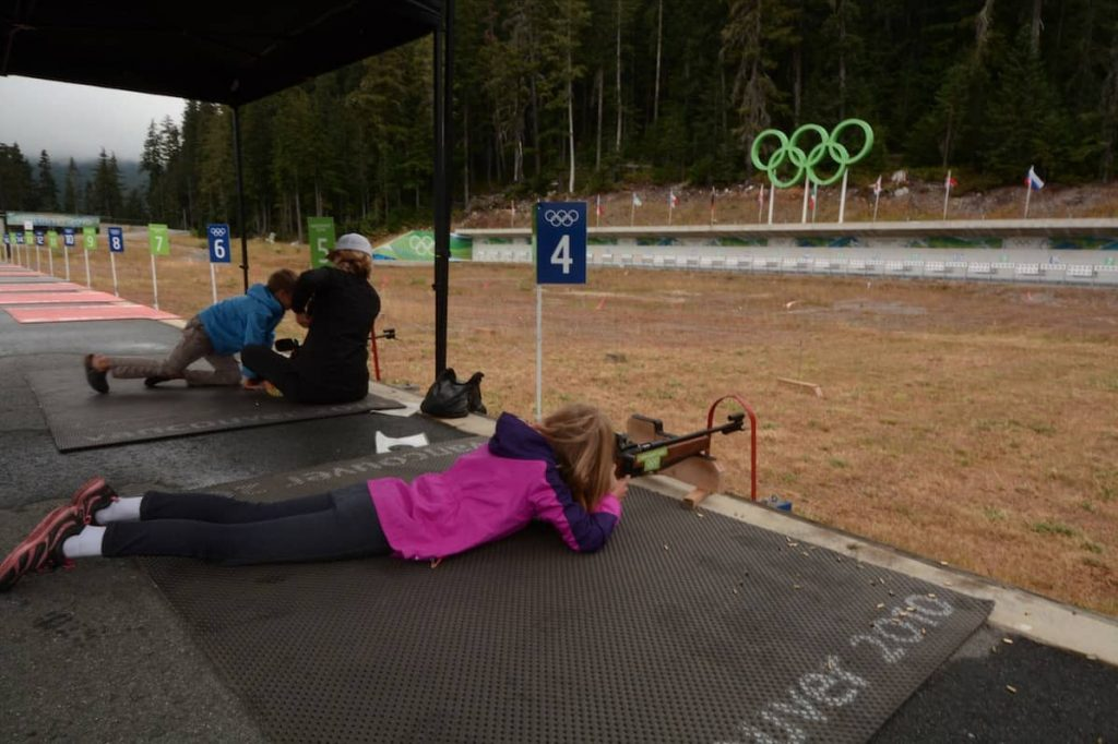 Children learning biathalon rifle shooting in Whistler Olympic Park in British Columbia