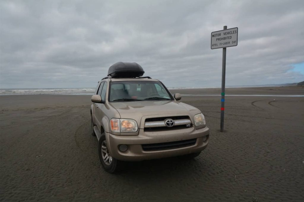 Gold Toyota Sequoia on the beach at the Oregon coast