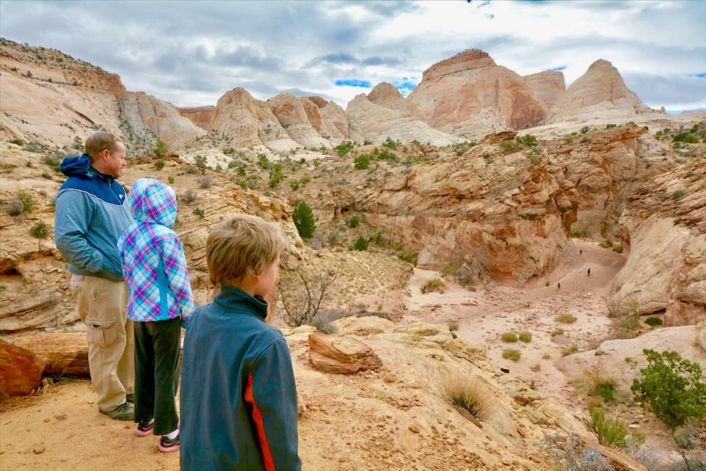 A family overlooks Capitol Reef National Park in southern Utah