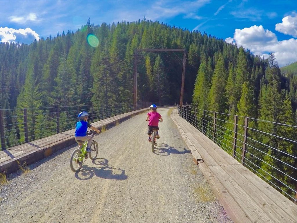 Children riding bikes along the Hiawatha Bike Trail in the Idaho panhandle