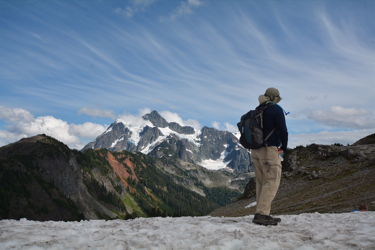 A man looks out at Mount Shuksan in North Cascades National Park
