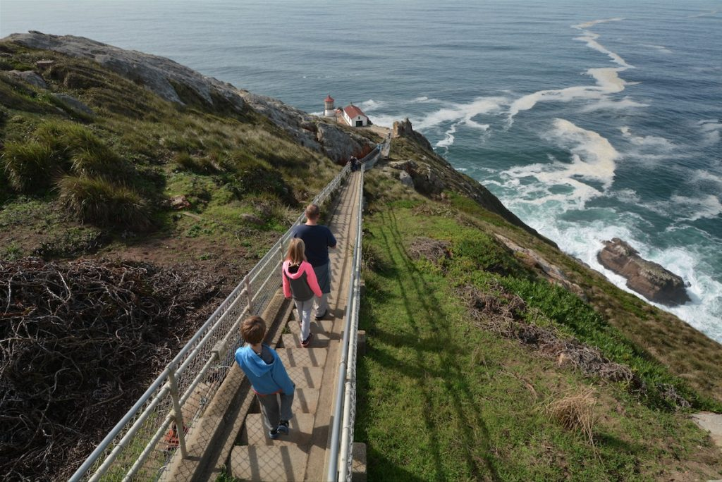 A family descending hundreds of steps to Point Reyes Lighthouse on Point Reyes National Seashore