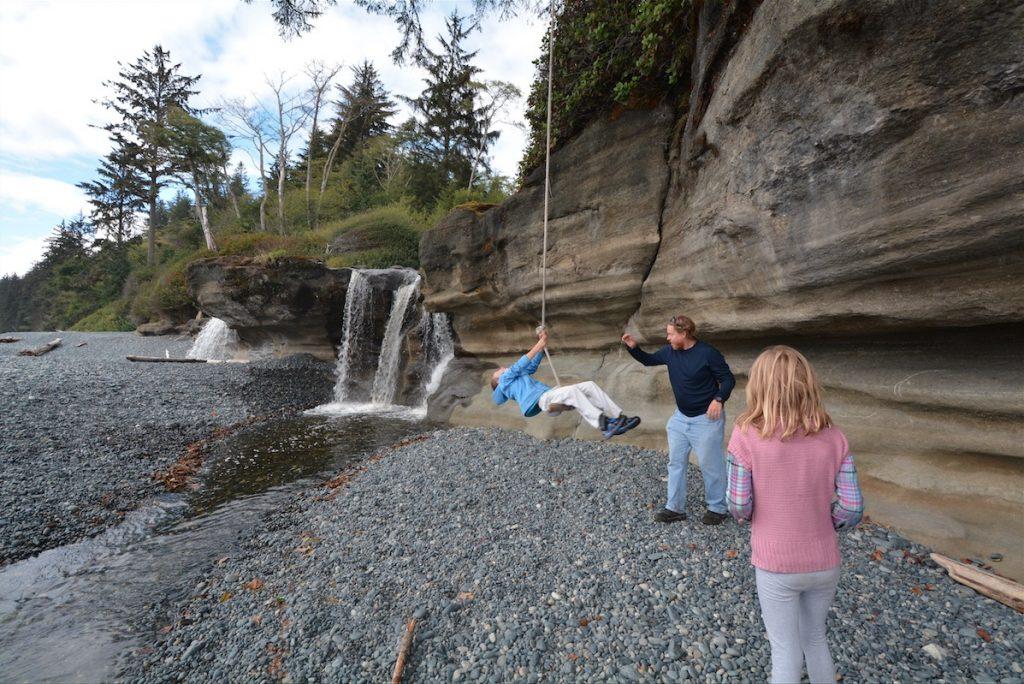 A family enjoys a beach swing along the Oregon coastline
