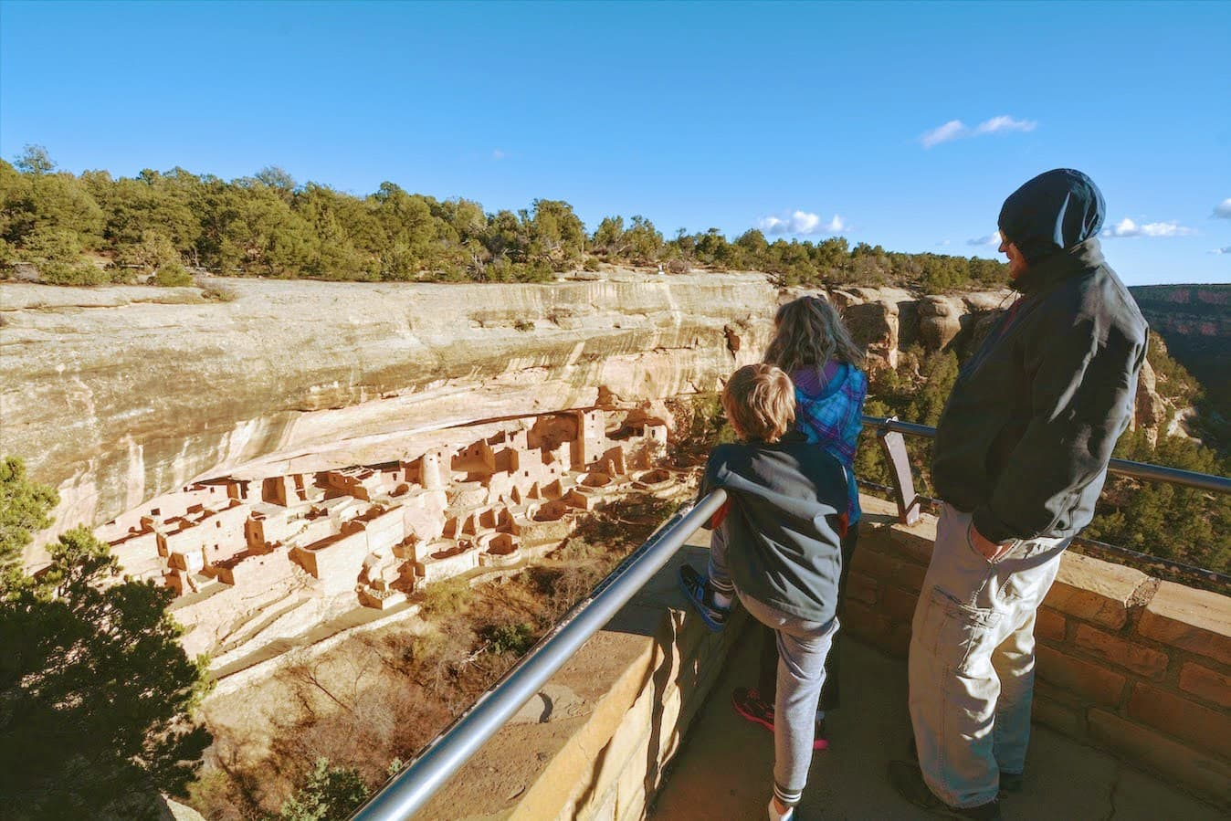 A family overlooks the cliff dwellings in Mesa Verde National Park in southwest Colorado.
