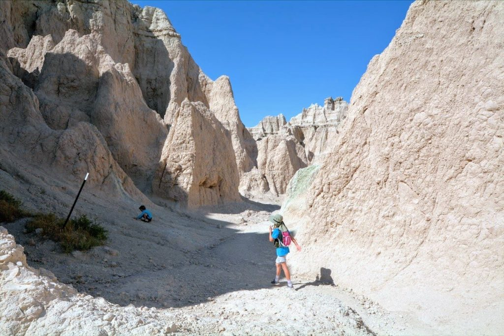 A family hikes along the Notch Trail in Badlands National Park, South Dakota
