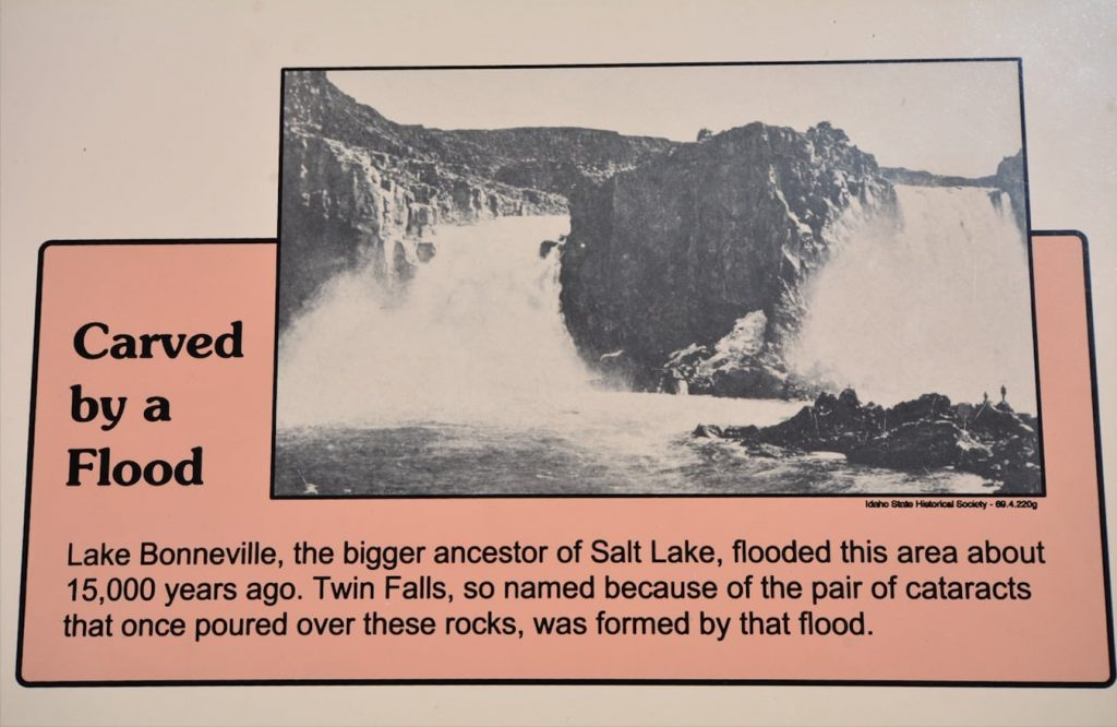 A signboard at Twin Falls state park shows a historic photograph of the original double falls, as well as info on the Lake Bonneville flood which created them.