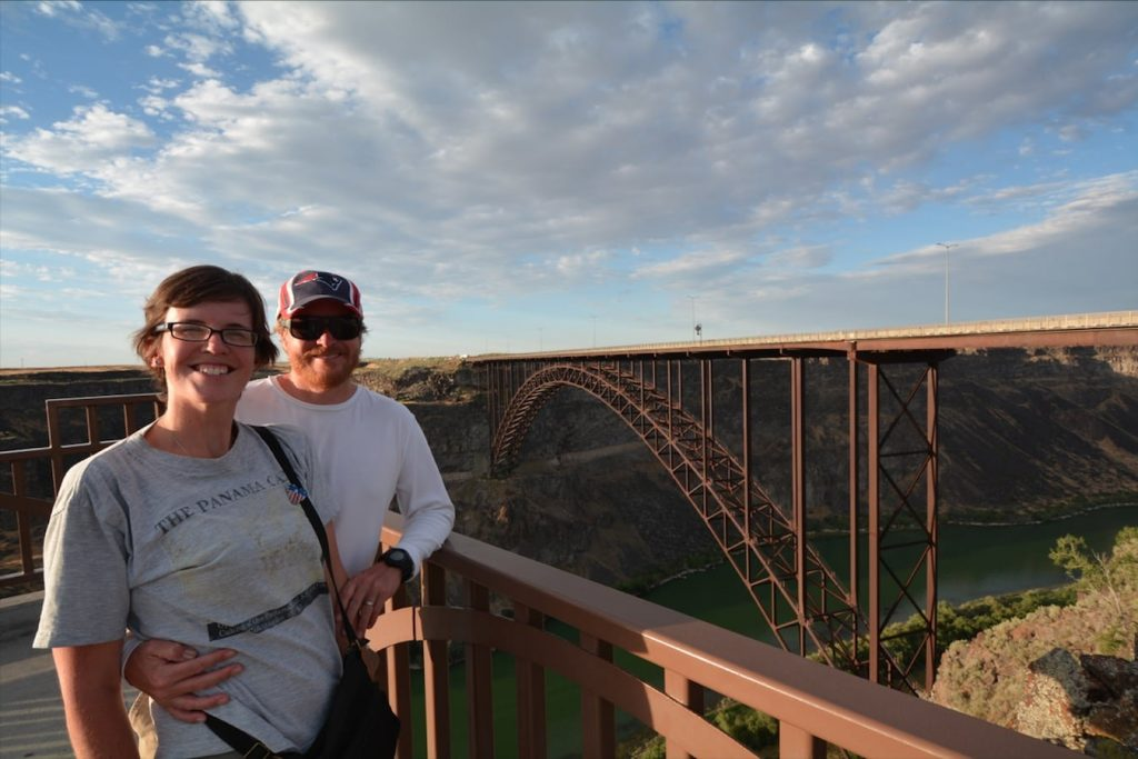 A couple overlooking the I.B. Perrine bridge which spans the Snake River Canyon in Twin Falls, Idaho
