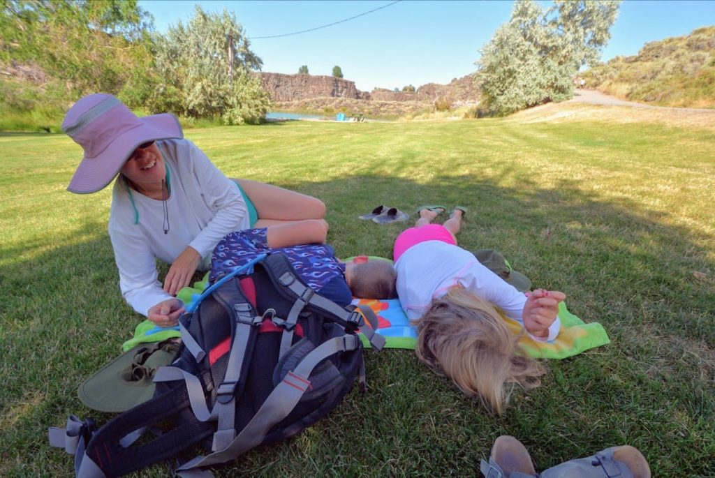 A family napping on the green lawns of Shoshone Falls State Park in Twin Falls, Idaho
