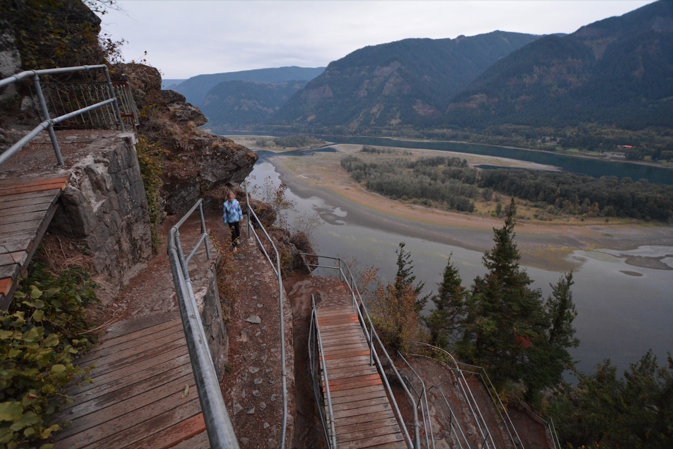 A girl hikes down from Beacon Rock in Beacon Rock State Park in the Columbia River Gorge, Oregon
