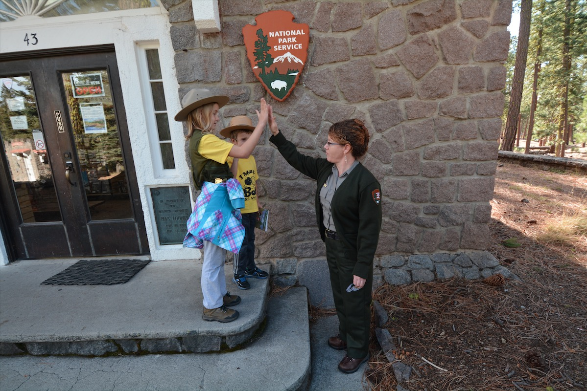 Syblings being sworn in as national park junior rangers.