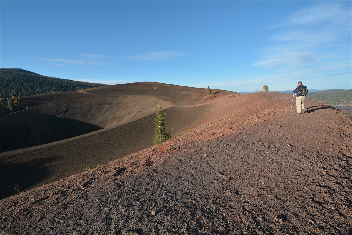 A man hikes along what was formerly part of Cinder Cone National Monument is now a part of Lassen Volcanic National Park