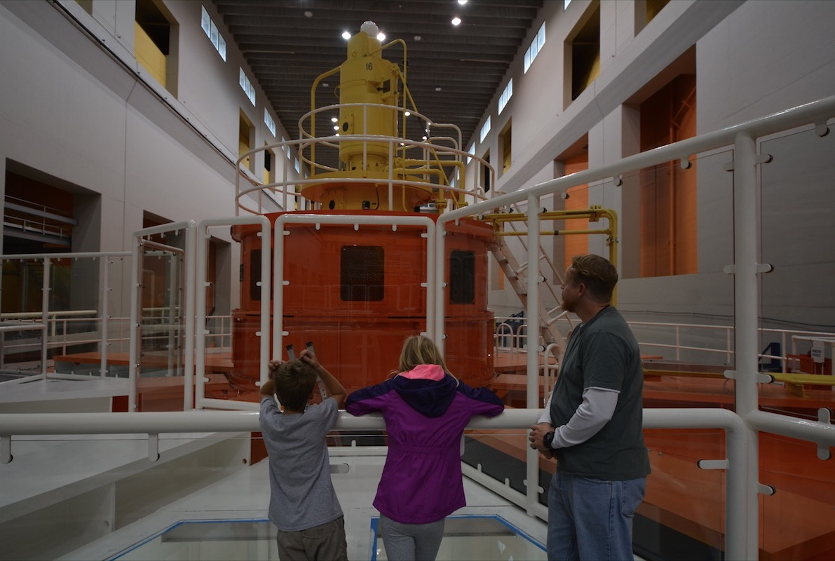 A family views the hydroelectric generators at the Bonneville Dam in the Columbia River Gorge between Oregon and Washington
