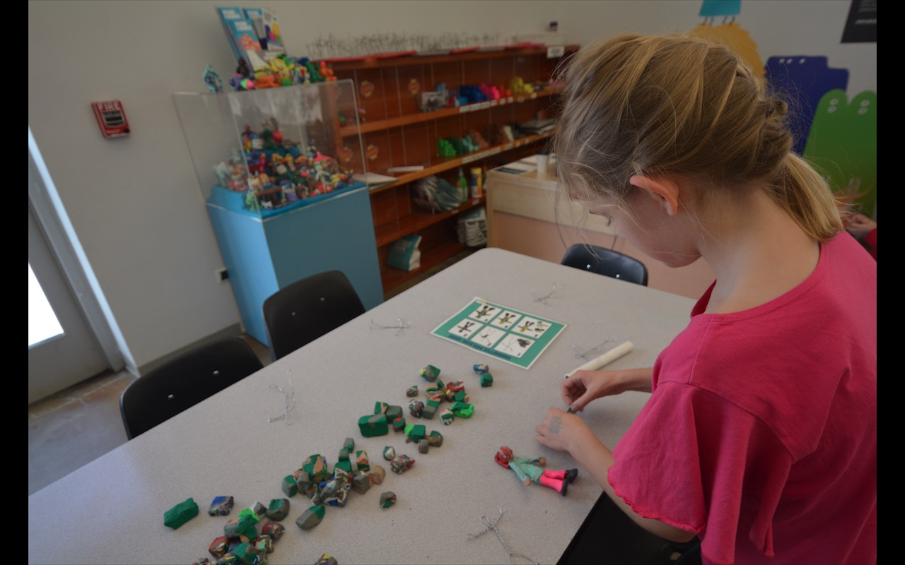 A girl learns claymation at Seattle Children's Museum