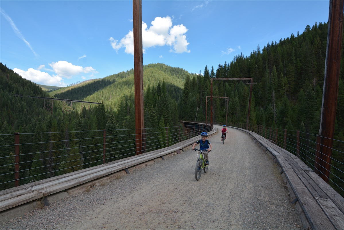 Children ride their bikes along the Route of the Hiawatha Mountain Bike Trail