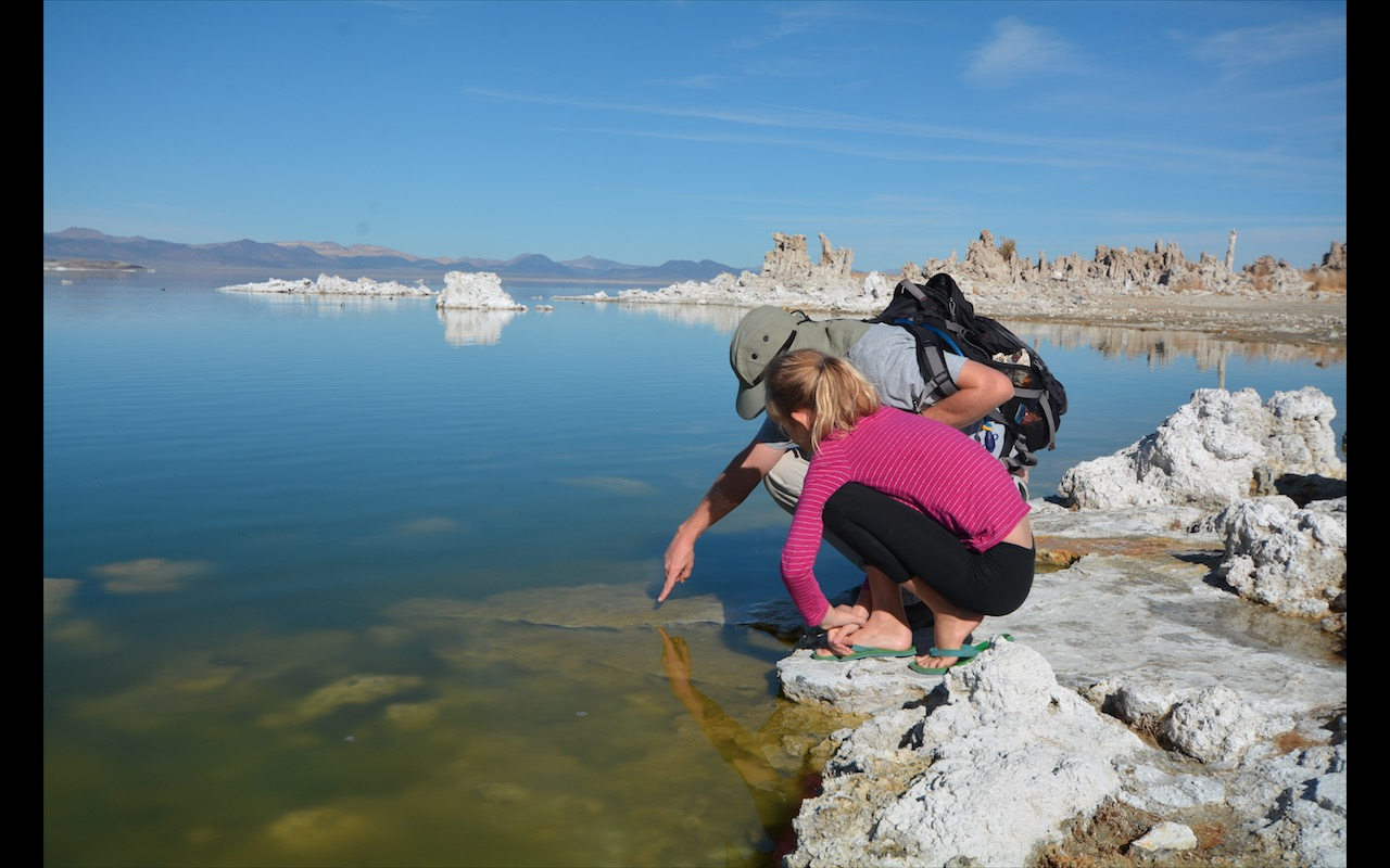 Father and daughter examine Mono Lake in California, just outside of Yosemite National Park