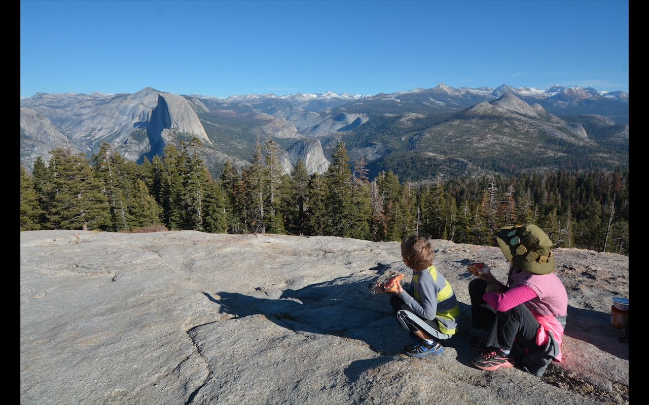Two siblings overlook Half-Dome in Yosemite National Park