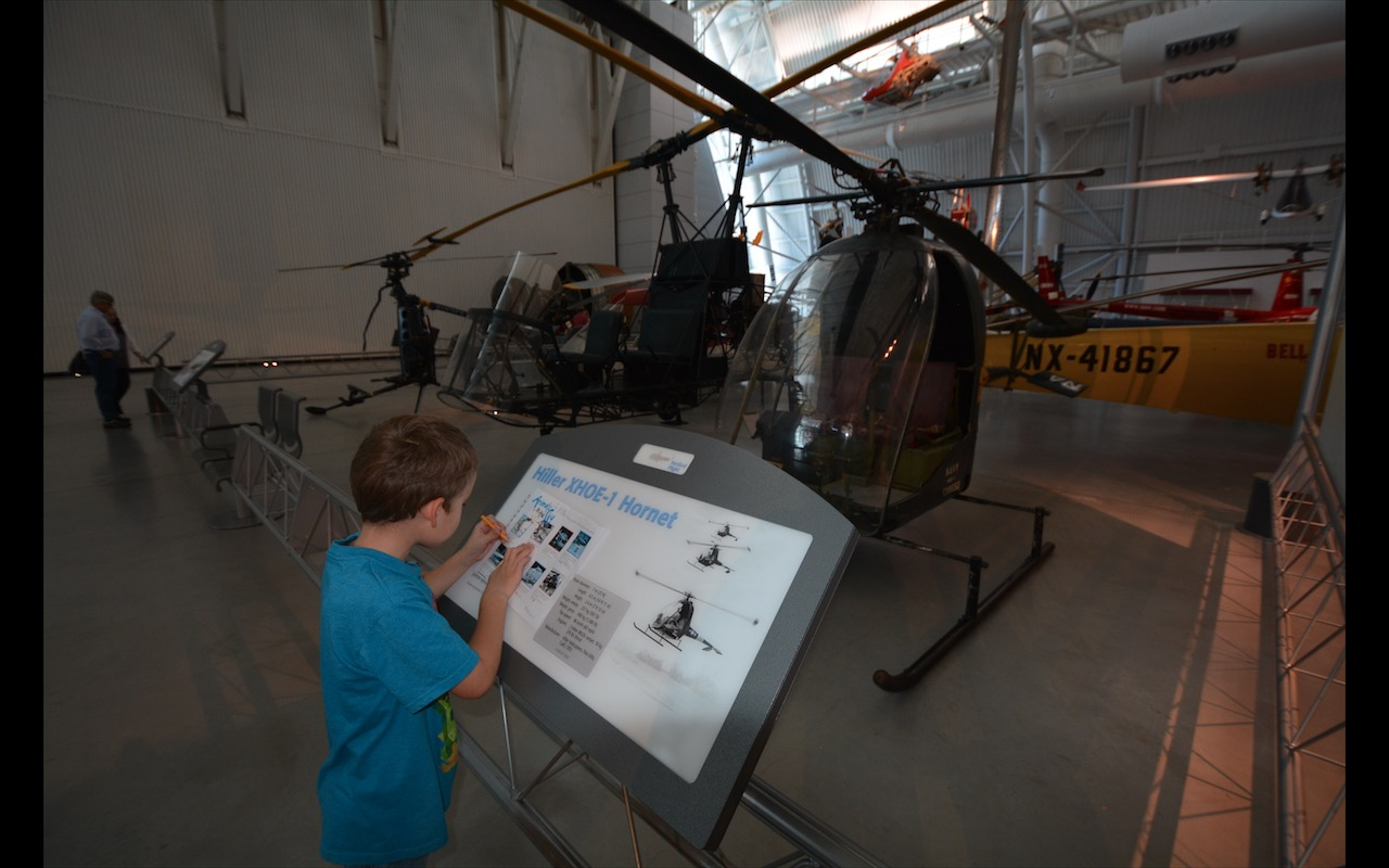 A young boy completes a scavenger hunt at Steven F. Udvar-Hazy Center, National Air and Space Museum, Chantilly, Virginia